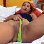 Asian hottie pulls her green panties through her hot pussy