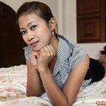 Cute Asian girl strikes an adorable pose