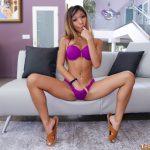 Petite teen models in her bikini while masturbating